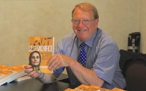 "Struan Stevenson holds his book ""Self Sacrifice"""