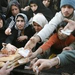 People queuing up to get bread ration.