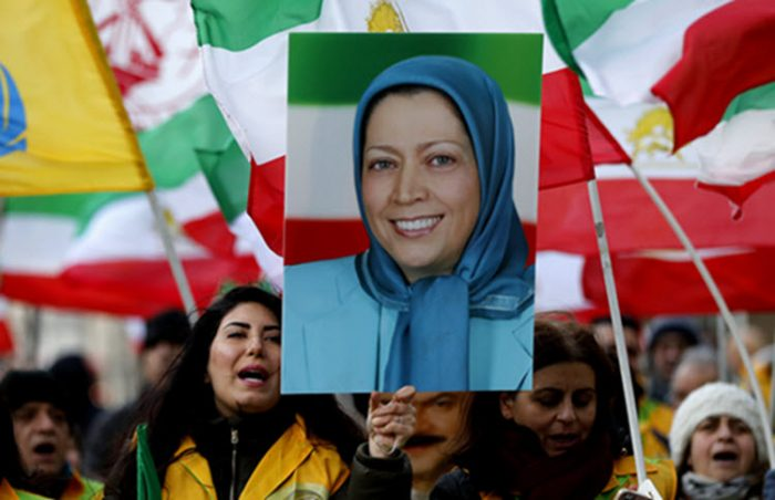 Protester hold's Maryam Rajavi's photo in a rally in London.