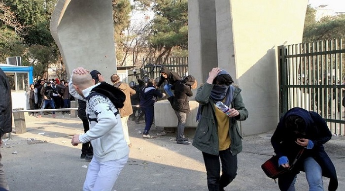 Students protest against the repressive Iranian regime forces.