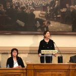 Ingrid Betancourt speaking at a conference in the French Parliament.