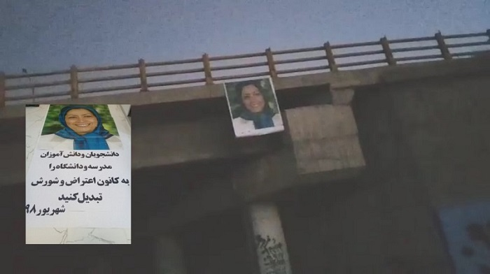 Banner of Maryam Rajavi hanging over a bridge in Iran