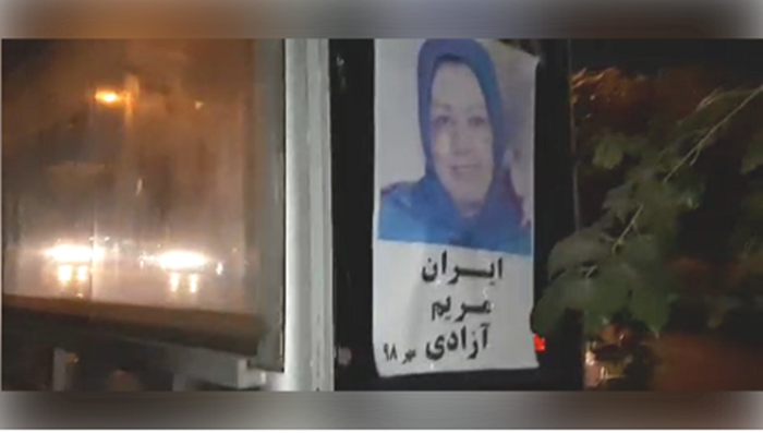 A large placard carrying Maryam Rajavi's picture posted in Modares Highway, Tehran by a MEK resistance unit