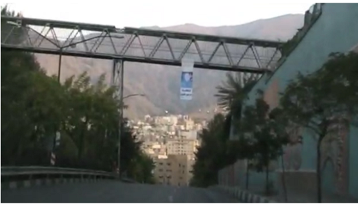 A large placard carrying Maryam Rajavi's picture was hung over a bridge in Abbasabad, Tehran by a MEK resistance unit