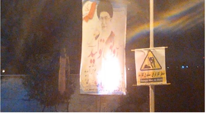 Torching a banner of Ali Khameni in Tehran by a MEK resistance unit1