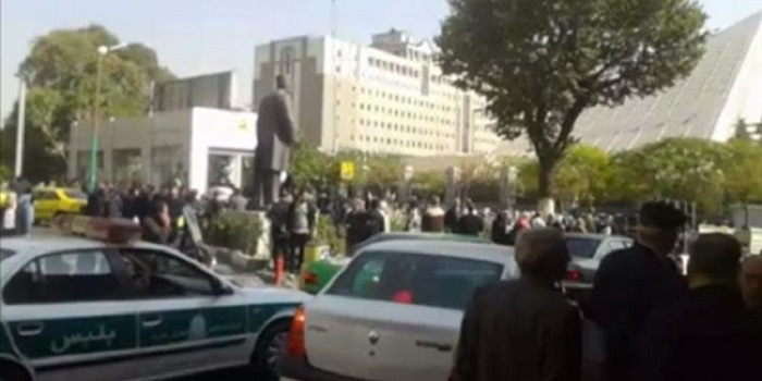Retirees gather out side the regime's parliament